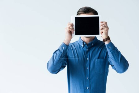 man covering face with tablet with blank screen isolated on white