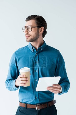 handsome young man with paper cup of coffee and tablet isolated on white