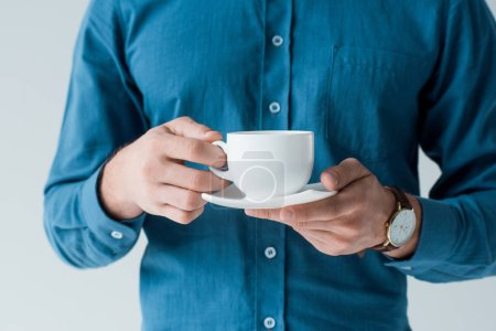 cropped shot of man with cup of coffee isolated on white
