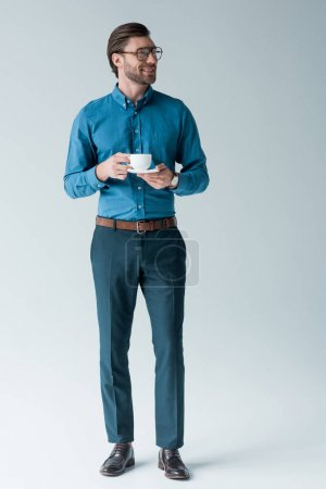 Photo for Smiling young man with cup of coffee on white - Royalty Free Image