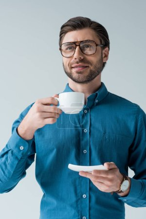 attractive young man with cup of coffee isolated on white