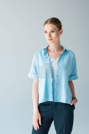 Photo for Beautiful young woman in stylish blue shirt isolated on grey - Royalty Free Image