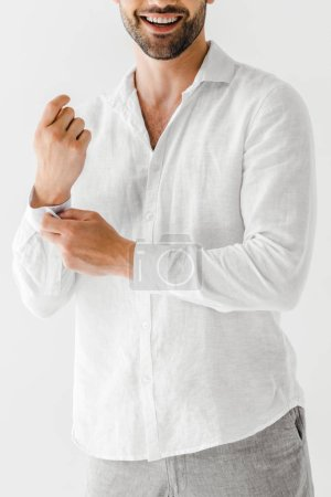 cropped image of smiling man in linen white shirt isolated on grey background