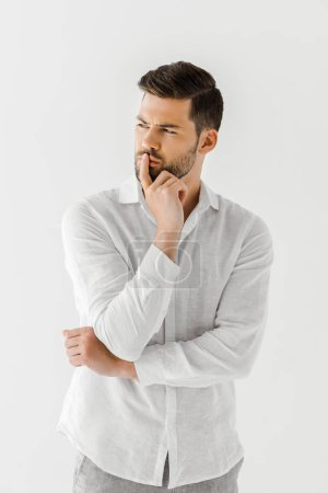 thoughtful man in linen white shirt isolated on grey background