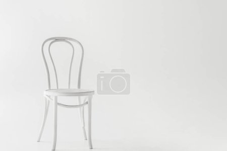 front view of white chair isolated on grey background
