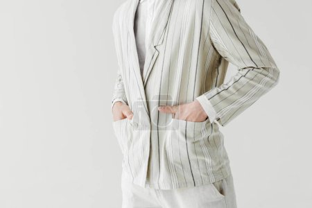 cropped shot of man in vintage striped jacket with hands in pockets isolated on white