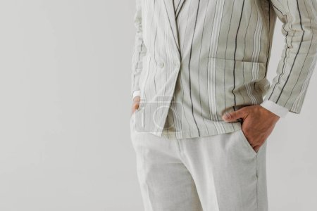 cropped shot of man in vintage striped jacket and pants isolated on white