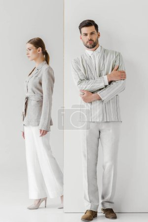 male and female models in stylish vintage clothes on white