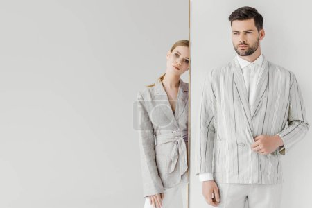 Photo for Attractive male and female models in stylish vintage clothes on white - Royalty Free Image