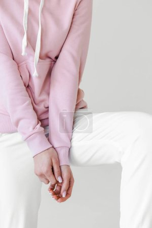 cropped shot of woman in pink hoodie isolated on white