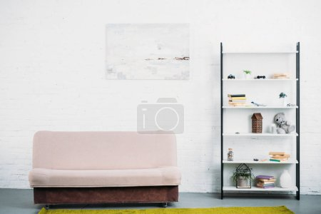 Photo for Interior of modern light living room with couch and bookshelves - Royalty Free Image