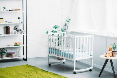interior of modern light childrens room with crib