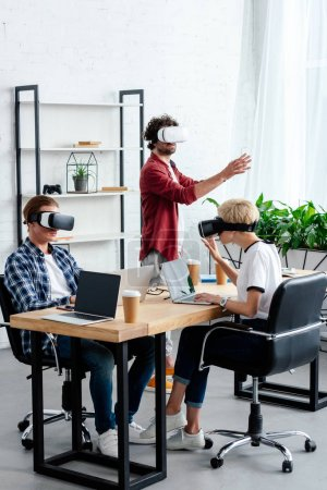 young people using virtual reality headsets while working together