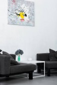 paint on wall, black modern armchairs in living room