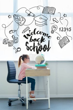 Side view of little schoolgirl studying with books and laptop at home, with icons welcome back to school lettering
