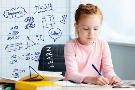 adorable red haired schoolgirl sitting at desk and studying at home with math icons