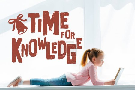 "adorable little schoolgirl reading book and lying on windowsill with ""time for knowledge"" lettering"