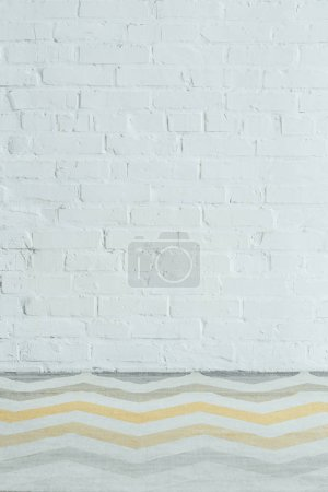 white wall with bricks and paints in office