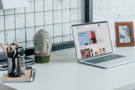 Laptop with loaded ebay page on table in modern office