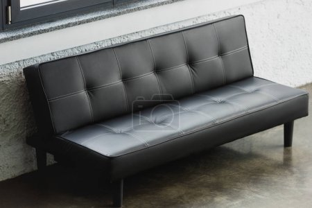 modern empty black couch in office