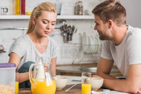 Photo for Young couple having breakfast in kitchen - Royalty Free Image