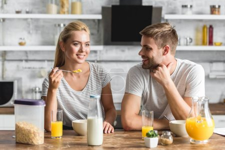 Photo for Cheerful couple having healthy breakfast in kitchen - Royalty Free Image