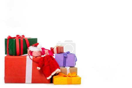 christmas hat and vest on pile of gift boxes isolated on white background