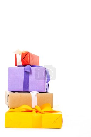 stack of colorful gift boxes isolated on white background