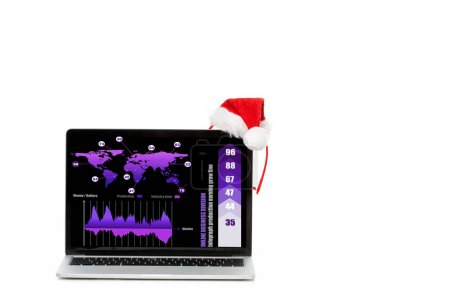 christmas hat on laptop with infrographic on screen isolated on white background