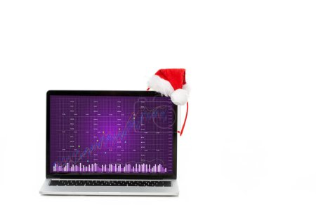 christmas hat on laptop with graph on screen isolated on white background