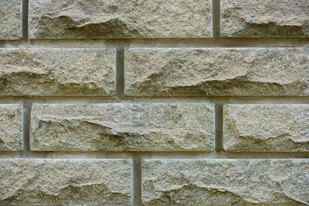 close-up view of grey brick wall texture, full frame background