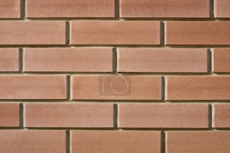 close-up view of red brick wall texture, full frame background