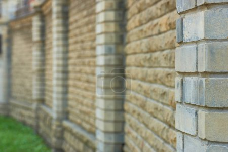 close-up view of brick wall background, selective focus