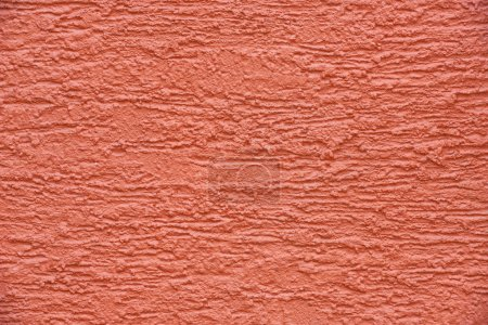 close-up view of red concrete wall textured background