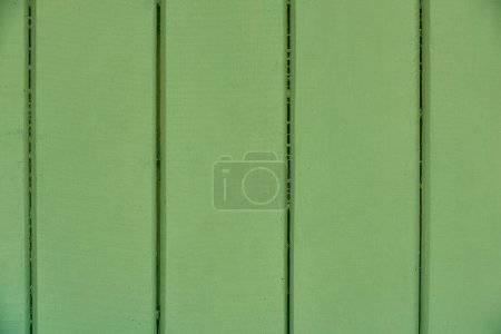 close-up view of green wooden planks texture, full frame background