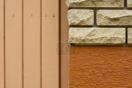 close-up view of bricks, rough wall and wooden planks background