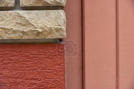 Photo for Close-up view of bricks, red wall and wooden planks background - Royalty Free Image