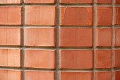 full frame view of red weathered brick wall textured background