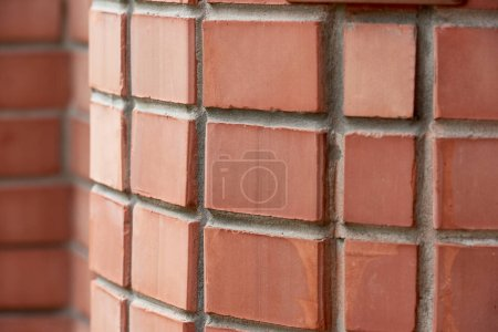 close-up view of red brick wall background, selective focus