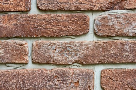 close-up view of old red brick wall background