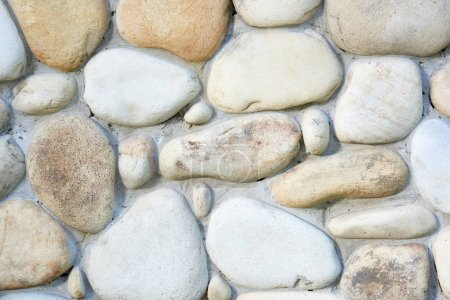 close-up view of light stone wall textured background