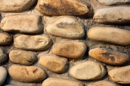 close-up view of rough stone wall textured background