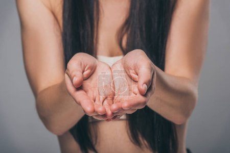 Photo for Close-up partial view of brunette woman holding fallen hair in hands, hair loss concept - Royalty Free Image
