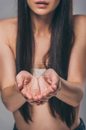 cropped shot of brunette woman holding fallen hair in hands, hair loss concept