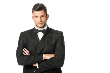 Photo for Handsome young man in black suit with bowtie with crossed arms isolated on white - Royalty Free Image