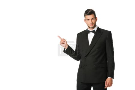 Photo for Handsome young man in suit pointing at blank space isolated on white - Royalty Free Image