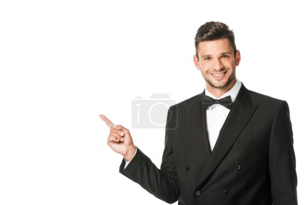Photo for Happy young man in suit pointing at blank space isolated on white - Royalty Free Image