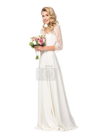happy bride holding bouquet and looking at camera isolated on white
