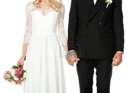 cropped shot of newlyweds holding hands tied in chain isolated on white