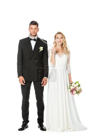 Photo for Beautiful young bride with chain and leashed groom looking at camera isolated on white - Royalty Free Image